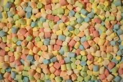 Colorful mini marshmallows background stock image