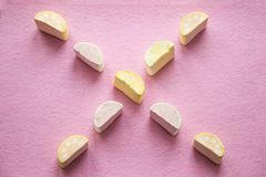 Colorful mini marshmallows on pink background, closeup. Fluffy marsh mallows texture and pattern. Colorful mini marshmallows isolated on pink background Stock Photos
