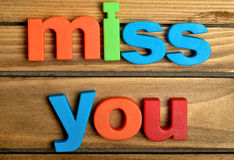Colorful miss you word. On wooden table Stock Image