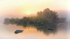 Colorful misty dawn at the lake Stock Photography