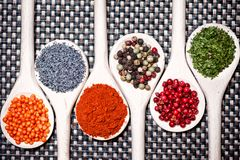 Colorful mix of assortment spices with bean seeds, poppy seeds Stock Photo