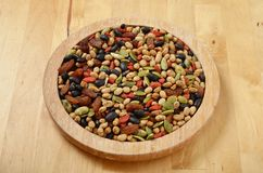 Colorful mix cereals, grain and seeds. On wooden plate royalty free stock photography