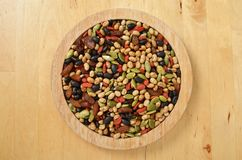 Colorful mix cereals, grain and seeds. On wooden plate stock image