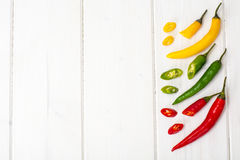 Colorful mix of the freshest and hottest chili peppers Stock Photos