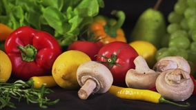 Colorful mix of fruits and vegetables. Black background stock video footage