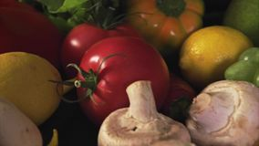 Colorful mix of fruits and vegetables stock video footage