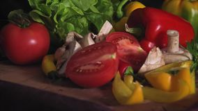 Colorful mix of fruits and vegetables stock footage