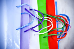 Colorful mix of paper gift bags. Bright colored shopping bags arranged on top of each other Stock Photo