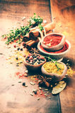 Colorful mix of various spices and herbs Stock Images