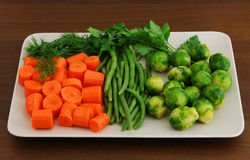 Colorful mix of vegetables on grey ceramic dish Stock Photo