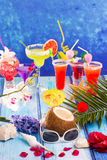 Colorful mixed cocktails in tropical blue wood Royalty Free Stock Photo