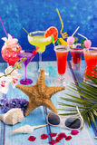 Colorful mixed cocktails in tropical blue wood Stock Images