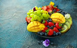 Colorful Mixed Fruit platter with Mango, Strawberry, Blueberry, Kiwi and Green Grape. Healthy food Royalty Free Stock Photography