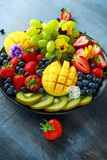 Colorful Mixed Fruit platter with Mango, Strawberry, Blueberry, Kiwi and Green Grape. Healthy food Stock Image