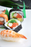 Colorful mixed sushi set. On white plate Royalty Free Stock Photo