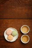 Colorful mochi rice cake on white plate and porcelain cups with Royalty Free Stock Images