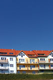 Colorful modern apartments. Row of colorful modern apartment buildings with blue sky background and copy space Stock Photos
