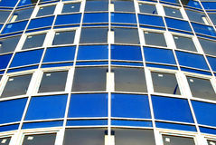 Colorful modern building. Colorful facade of modern windowed building royalty free stock image