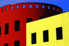 Colorful modern buildings. Exterior of colorful unique modern buildings in yellow and red with blue sky background Stock Photography