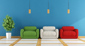 Colorful modern living room. With three armchair on blue wall - 3d rendering Stock Photo