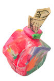 Colorful moneybox house with dollar Stock Photo