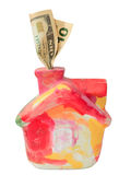 Colorful moneybox house with dollars Stock Photo