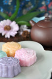 Colorful Mooncake and Tea pot on Background Stock Images