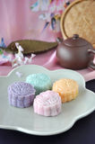 Colorful Mooncake with Tea Pot on Background Royalty Free Stock Photo