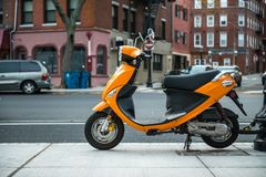 Colorful Moped locked up on city street. City transportation concept.  stock photos