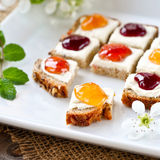 Colorful morning!. Slice of bread with different kinds of jam Stock Photography