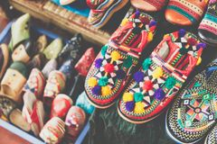 Colorful Moroccan shoes alignment in a shop. Oriental shoes in a. Bazaar. Multicolored Moroccan slippers. Colorful leather slippers for sale in the souk in Stock Photography