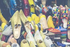 Colorful Moroccan shoes alignment in a shop. Oriental shoes in a. Bazaar. Multicolored Moroccan slippers. Colorful leather slippers for sale in the souk in Stock Photos