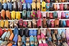 Colorful Moroccan shoes at Marrakech souk market, Morocco. stock photo