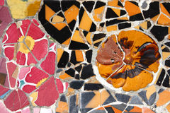 Colorful mosaic. In Antoni Gaudi's Park Guell - Barcelona detail. Artistic background texture of trencadis Stock Image