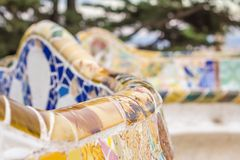 Colorful mosaic bench of park Guell in Barcelona Stock Image