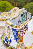 Colorful mosaic bench of park Guell in Barcelona Stock Images