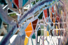 Colorful Mosaic Detail. A close-up shot of an outdoor mosaic shows a pattern of colorful shards of glass Royalty Free Stock Photos