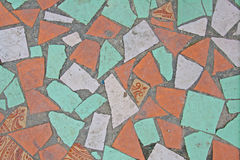 Colorful mosaic on the floor of broken ceramic tiles Royalty Free Stock Photos