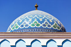 Colorful mosaic of an oriental roof. On blue sky background Stock Photos
