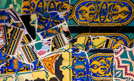 Colorful mosaic at the Park Güell, Barcelona. Multicolored tiles at the Park Güell, Barcelona, Spain Royalty Free Stock Image
