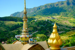Colorful mosaic pattern on pinnacle of Thai pagoda. Colorful mosaic pattern on pinnacle of Thai pagoda with mountain at Wat Phasornkaew in Thailand. Photo taken royalty free stock photo