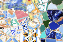 Colorful mosaic texture. Colorful mosaic in Antoni Gaudi's Park Guell - Barcelona detail. Artistic background texture of trencadis Stock Photo