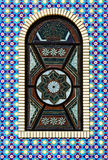 Colorful mosaic texture window. In the wall Royalty Free Stock Image