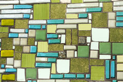 Colorful mosaic on the wall, abstract glass background. Royalty Free Stock Photos