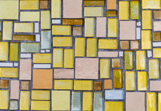 Colorful mosaic on the wall, abstract glass background. Royalty Free Stock Photography