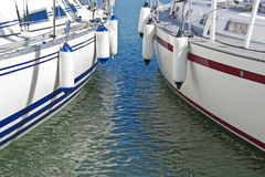 Colorful motorboats on calm water stock photo