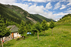 Colorful mountain hut with sky and clouds Royalty Free Stock Photos