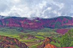 Colorful mountains. And grasslands under the clouds Royalty Free Stock Photos