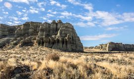 Cliffs in desert in Oregon. Colorful mudstone cliffs at the Pillars of Rome in the high desert of eastern Oregon Royalty Free Stock Image