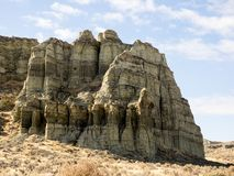 Cliffs in desert in Oregon. Colorful mudstone cliffs at the Pillars of Rome in the high desert of eastern Oregon Royalty Free Stock Photo